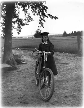 Well-dressed Girl Posing with her Bicycle