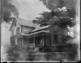 View of House with Woman on Front Porch