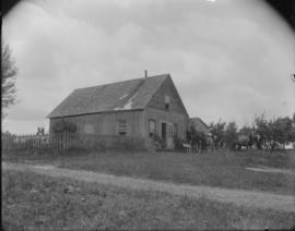 Wood House with Family and Horses Outside