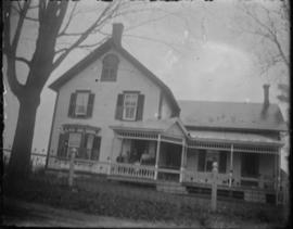 View of House with Family on Front Porch