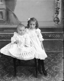 Portrait of Two Girls in White Dresses