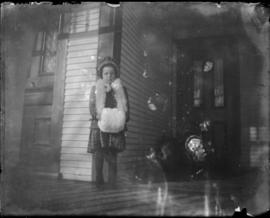 Young Girl on Front Porch wearing Winter Outfit