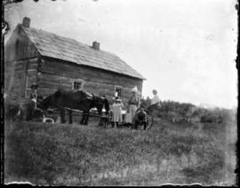 View of Log Cabin with Family and Horse Carriage