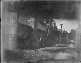 View of House and Road with Family Outside