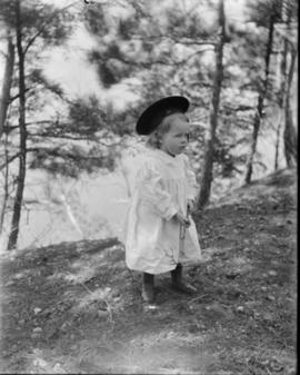 Young Child wearing a White Dress and Hat