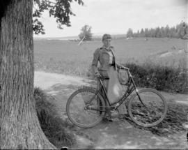 Woman posing with her Bicycle