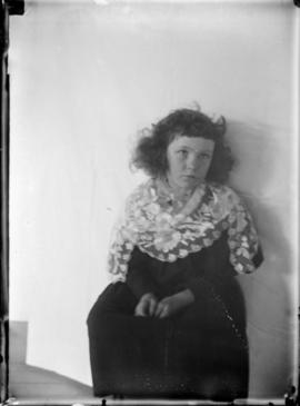 Portrait of a Young Curly-Haired Girl