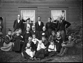 Portrait of an extended family outside of a house
