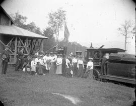 Excursion party at Chateau Foster on Lake Stukely (Bonnallie Lake), with Orford Mountain Railway locomotive visible