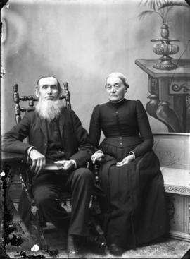Studio portrait of an elderly couple