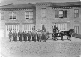 Men in front of fire station, Sherbrooke