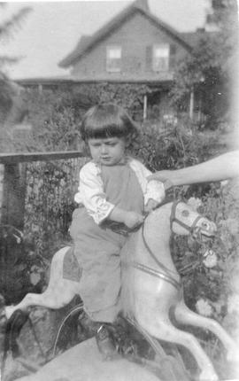 Young Child and Rocking Horse