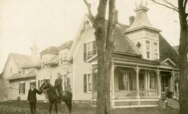 Abbott and Archie Jenks in front of the Jenks Home in Coaticook