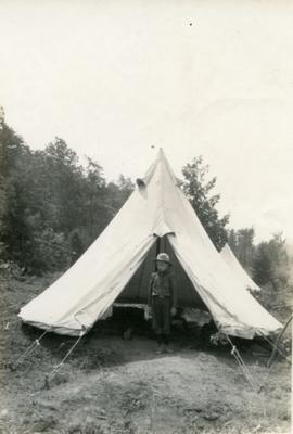 Boy Scout by tent