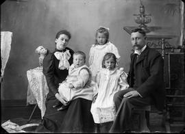 Man and woman with three children