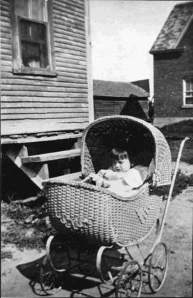 Child in a old carriage