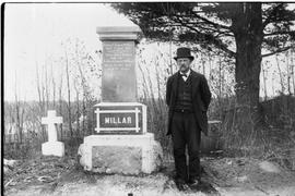 Robert Robins standing in St. George's Church cemetery, Drummondville