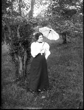 woman standing outside with parasol