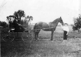 Ernie and John Cox with horse and carriage