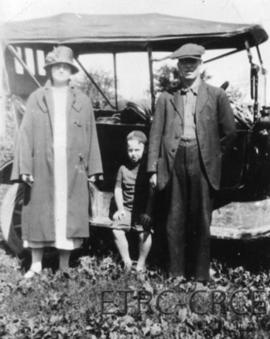 Myrtle, Gordon and Bill Forgrave beside their Model T