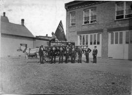 Men in front of fire station