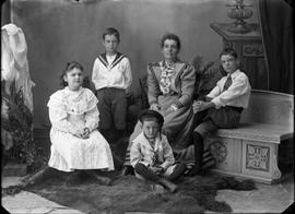 Studio portrait of a woman, a girl, and three boys