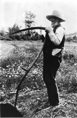 Farm labourer with scythe