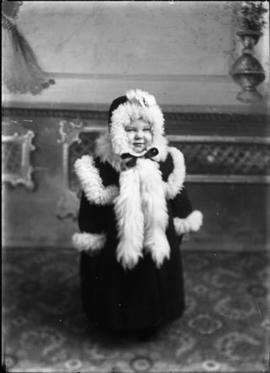 Child in fur-trimmed coat